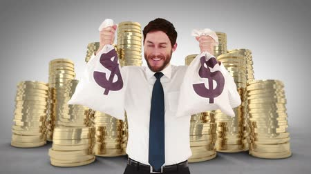 finanças : Composite video of happy businessman holding money bags Vídeos