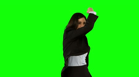 highspeed : Businesswoman punching on green screen in slow motion Stock Footage