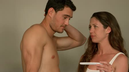 отцовство : Worried young couple finding out results of a pregnancy test in bathroom Стоковые видеозаписи