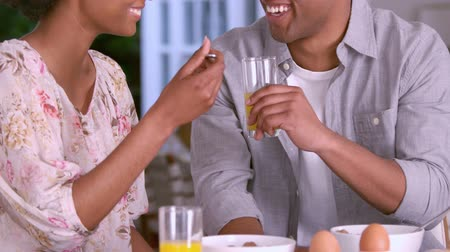 man eating : Smiling couple having breakfast together in slow motion Stock Footage