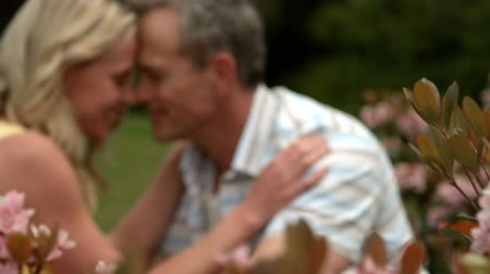 romantic couple : Mature happy couple having romance outdoors