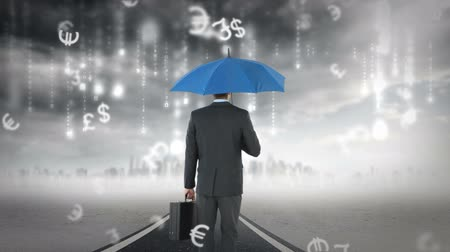 cüzdan : rear view of businessman holding umbrella under a storm Stok Video