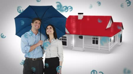 devise : Composite image of businessman and businesswoman holding an umbrella against house