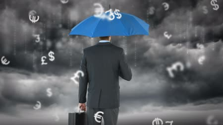 devise : rear view of businessman holding umbrella under a storm Stock Footage