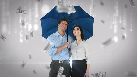 parceria : Composite image of business people standing under umbrella