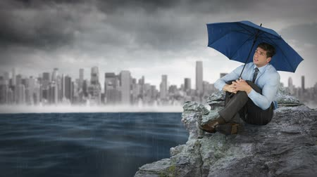 стоять : Composite animation of a businessman holding umbrella against storm