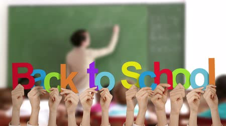 okula geri : Hands holding up back to school against school scene