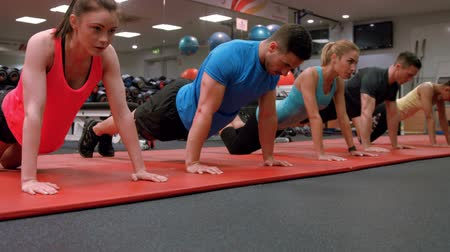 tornaterem : Fit people doing push ups in gym ultra hd format