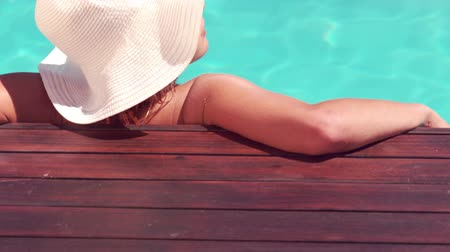 holiday villa : Attractive woman relaxing by the pool  in slow motion Stock Footage