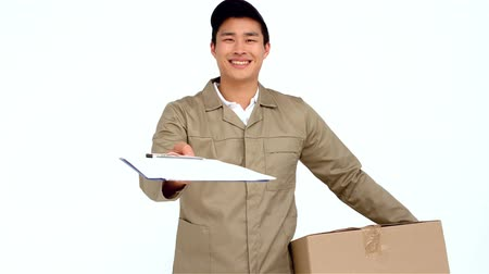 postacı : Smiling Asian postman handing document to sign on white screen