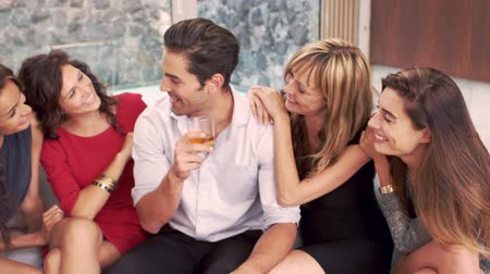 whisky : Handsome man with whiskey discussing with women in slow motion