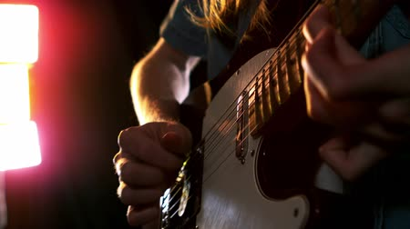 gitáros : Close up of man playing electric guitar in slow motion