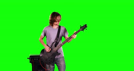 enstrümanlar : Man playing bass on green screen Stok Video