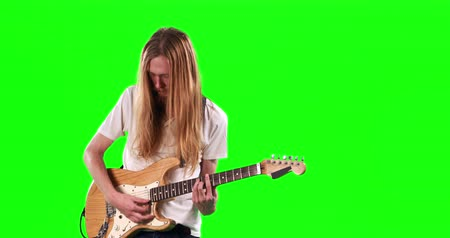 electric : Guitarist playing electric guitar on green screen