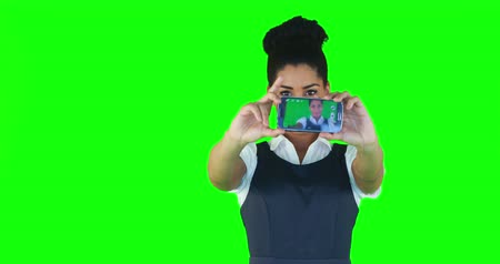 tenso : Pretty woman taking selfie on green screen Vídeos