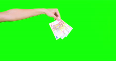 damlatma : Feminine hand dropping banknotes on green screen