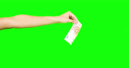 richness : Feminine hand dropping banknote on green screen Stock Footage