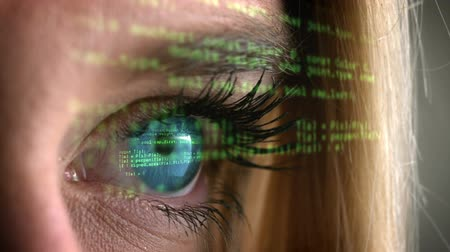 néz : Blue eye opening and looking at green codes scrolling