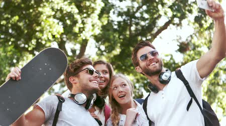 hipster : Smiling hipster friends taking selfie during road trip Stock Footage