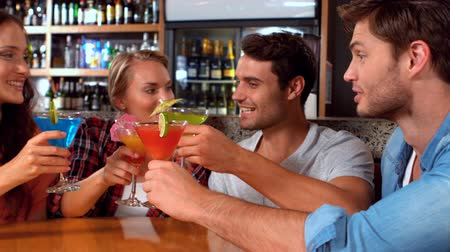 drink industry : Happy friends having a drink together in slow motion