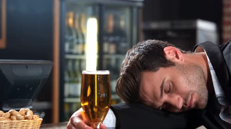 inebriated : Businessman with beer falling asleep in bar