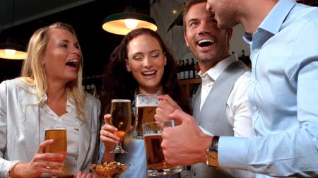 drink industry : Business people having a drink together in bar