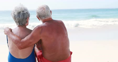 retirement : Old retired couple embracing each other on the beach