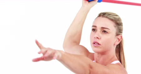 javelin : Smiling fit woman holding javelin on white screen Stock Footage