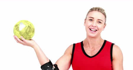protects : Smiling sportswoman plays handball on white background