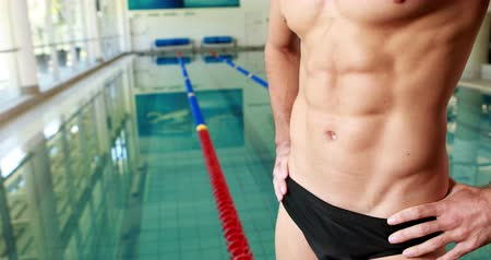 abs : Mid section of a fit swimmer by the pool Stock Footage