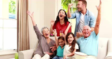home life : Happy family celebrating victory at home