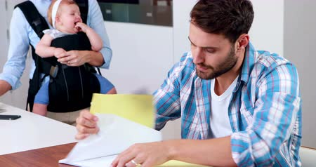 apprehensive : Worried man looking at documents in the kitchen Stock Footage