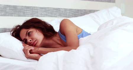 apprehensive : Thoughtful woman cant sleep in bedroom Stock Footage