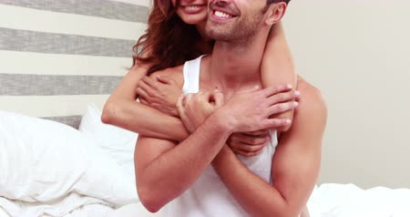 guy home : Woman embracing man from behind at home in bedroom Stock Footage