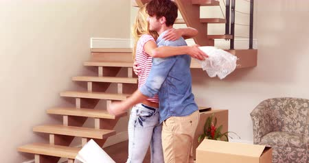 home life : Young lovely couple unpacking boxes at new home