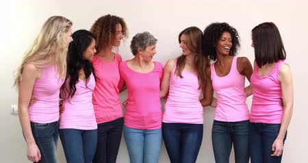 happy : Happy women with pink shirts standing in a row