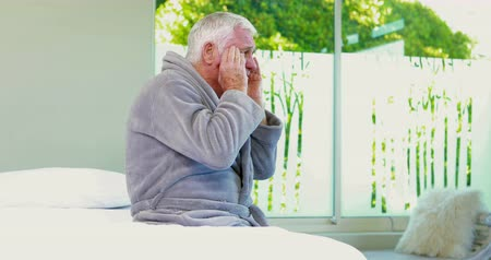 sufferance : Senior man having back and head pain on bed