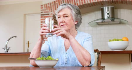 senior lifestyle : Senior woman eating salad at home