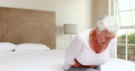 sufferance : Senior woman having a stomachache on bed