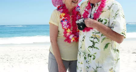 vacation : Smiling senior couple on the beach in slow motion