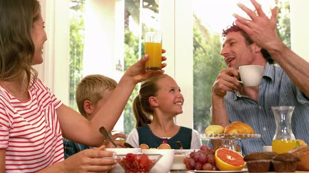 kahvaltı : Cute family having breakfast in the kitchen Stok Video