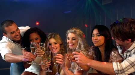 sparkling drink : Cute friends having cocktails at a party in a nightclub Stock Footage