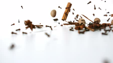 temperos : Spices falling on the ground on white background