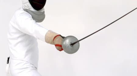 meç : Sportsman playing fencing on white screen Stok Video