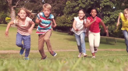 lento : Happy children having a sprint in a park