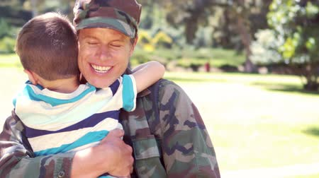 katonák : Handsome soldier reunited with his son in the garden