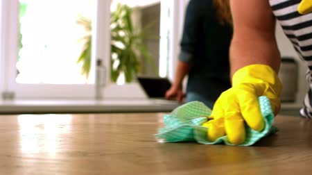 cleaning products : Handsome man cleaning table in kitchen Stock Footage