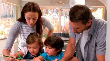 home life : Family drawing together in kitchen at home Stock Footage