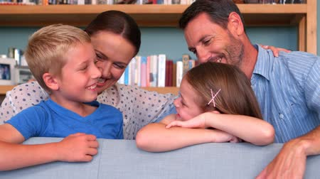 home life : Smiling family talking together at home