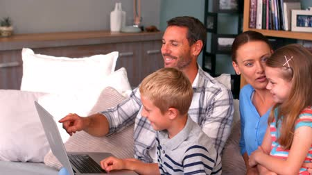 home life : Family using laptop on couch at home Stock Footage